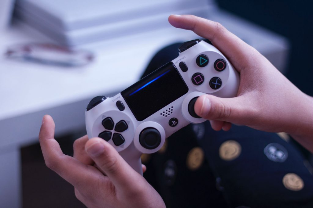 PlayStation 4 controller being used to play a game